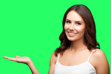Woman in showing copyspace or something, on green chroma key bac