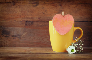 yellow mag with a wooden vintage pink heart