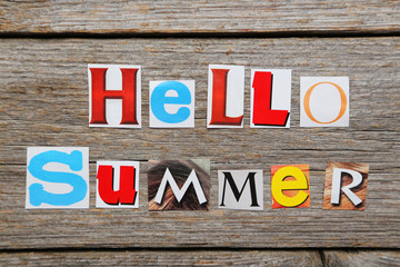 The word hello summer in cut out magazine letters