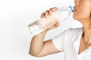Young woman with bottle of mineral water.