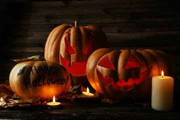 Halloween pumpkins on brown wooden background