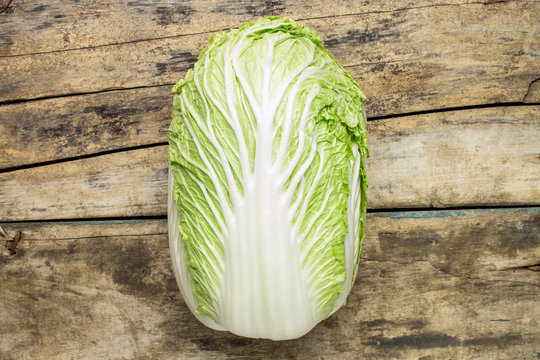 Fresh chinese cabbage on wooden background