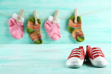 Colorful toddler shoes on wooden background