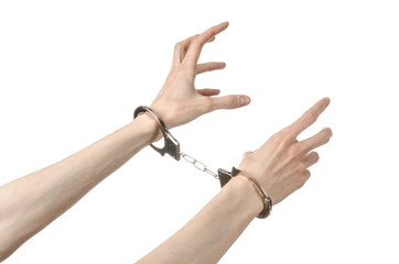 Prison and convicted topic: man hands with handcuffs isolated