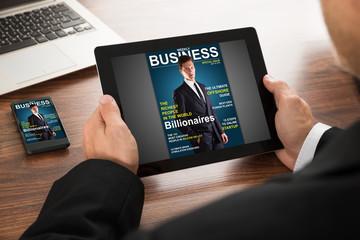Businessman Reading Online Magazine