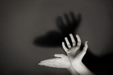 Hands gesture like deer on gray background