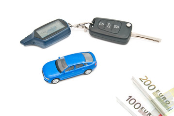 blue car, keys and notes on white