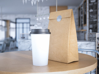 Coffe cup and paper bag on table. 3d rendering