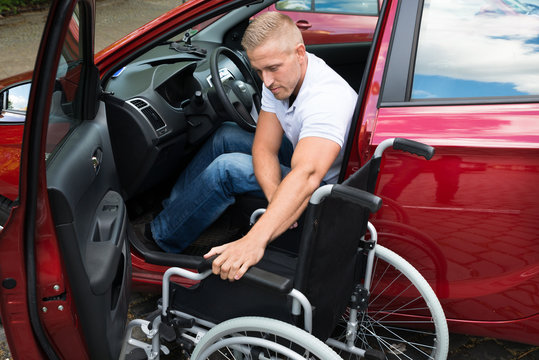 Handicapped Car Driver With A Wheelchair
