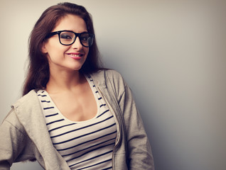 Happy young woman posing in fashion eye glasses. Vintage portrai
