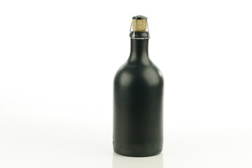 ceramic bottle with cork.
