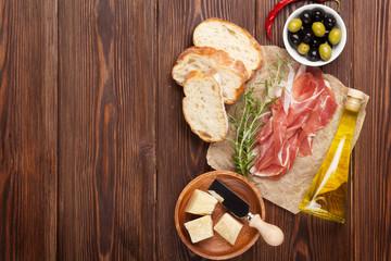 Bruschetta ingredients - prosciutto, olives, cheese