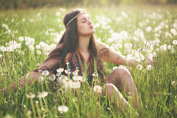Beautiful hippie woman enjoying sun