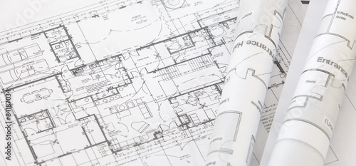 Wall mural Architect rolls and architectural plan,technical project drawing