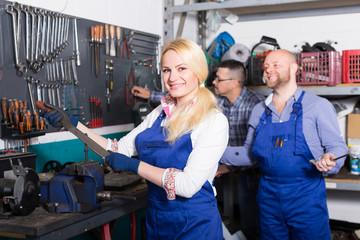 Auto mechanics at workshop