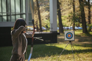 Businesswoman Pointing The Target With Bow And Arrow