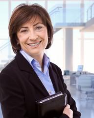 Portrait of happy senior businesswoman at office