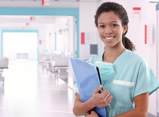 Afro american nurse at hospital with clipboard