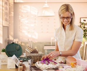Housewife making valentine day wreath at home