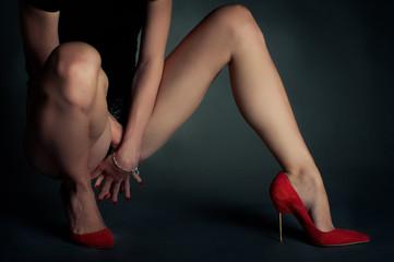 Red high heels on beautiful female legs