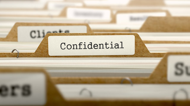 Confidential Concept with Word on Folder.