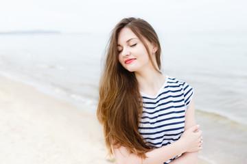 Beautiful stylish girl on sea beach