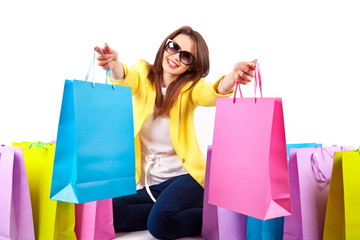 Beautiful girl in sunglasses with bags. Shopping