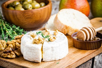 Camembert cheese with walnuts,  honey and baguette