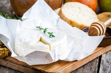 Camembert cheese with thyme,  honey and baguette