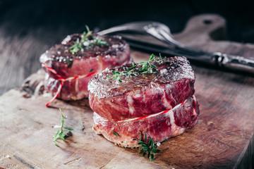 Keuken foto achterwand Vlees Rare Seasoned Venison Steak Filets on Wooden Board