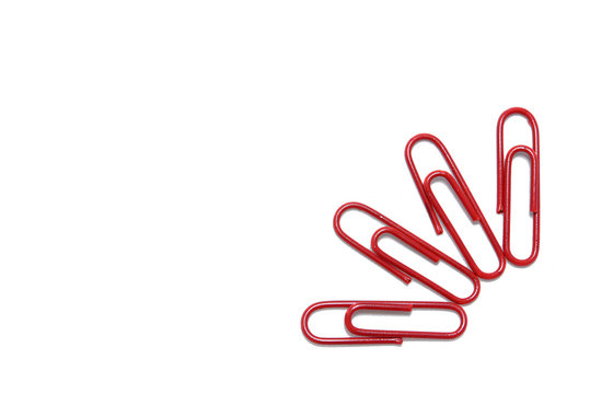 Red paper clip on isolated white
