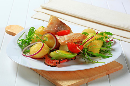 Fish skewer with potato side dish