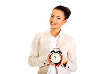 Businesswoman with alarm clock.