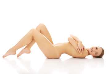Spa woman lying on the floor.