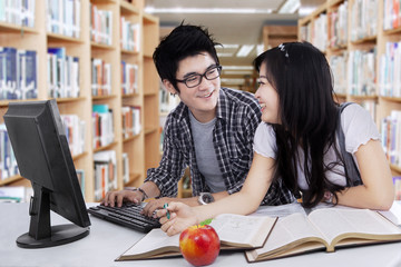 Two high school students studying together