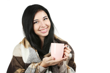 Portrait of young woman with cup and plaid on white background