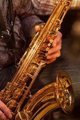 The saxophone in the hands of the musician