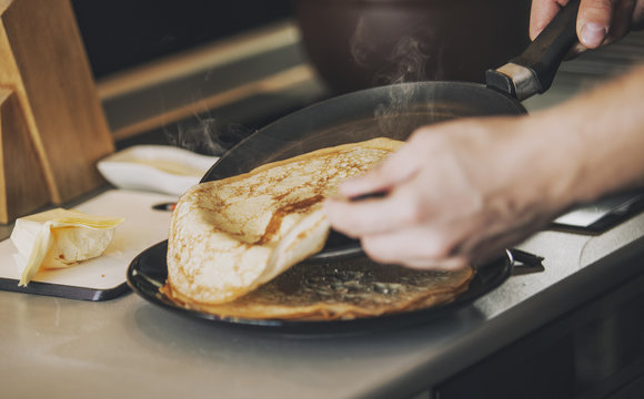 The process of cooking pancakes on a skillet