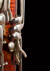 Fototapete - Fragment of the bassoon on a black background