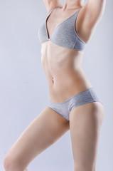 Slim woman in gray underwear.
