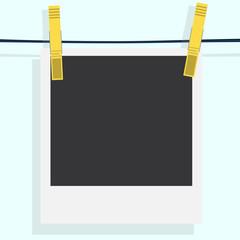 Polaroid photo frame with clothespin isolated on white backgroun