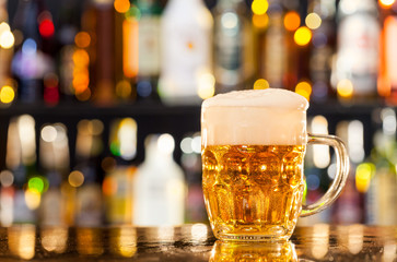 Jug of beer served on bar counter