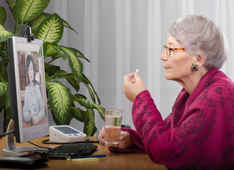 Patient taking pill during virtual physician visit