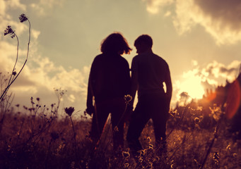Two inlove people evening silhouette