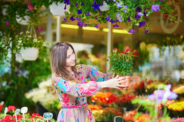 Customer selecting flowers in Parisian shop