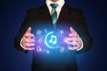 Man holding digital multimedia icons