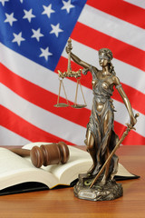 Themis and gavel on USA flag background