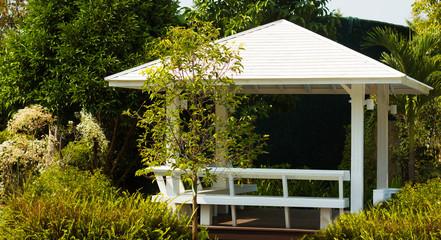 White pavilion in garden design Wall mural