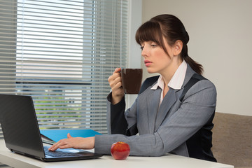 The image of business woman at coffee break in the office