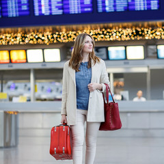 Young woman at international airport, goes to the gate